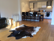 Black and white cowhide stools.