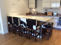 Cowhide bar stools in French chalet.