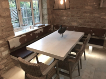 cowhide backrests and leather seating for dining area.