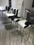 black and white cowhide bar stools with steel frames