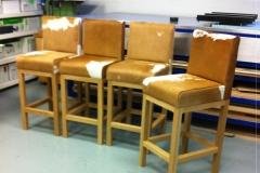 4-tan-cowhide-stools