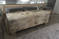 grey and white cowhide bench