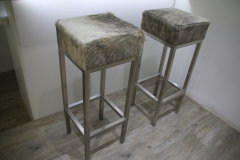 grey and white cowhide stools