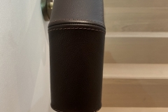 Downturn on leather handrails completed on-site by Hide and Stitch.
