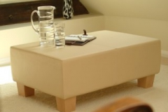 small leather and wood coffee table