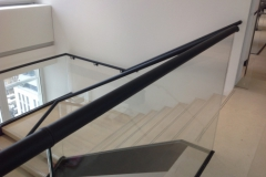 Continuous length of leather covered handrail