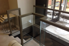 square handrail on glass balustrade.