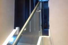 Leather handrails on glass balustrade.