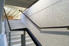 UCL, leather on brass handrail.