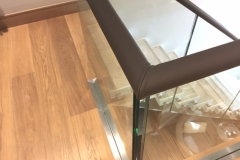 leather-covered-handrail-on-glass
