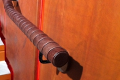 Tennis racket style wrapped leather handrail
