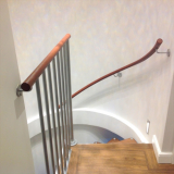 curving wall mounted leather handrail.