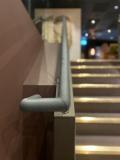 Round grey leather handrail in London Gaucho Restaurant