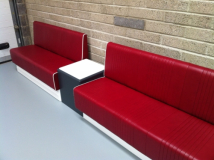 Fluted leather seating with contrast piping.