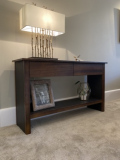 zebrano wood and leather console unit stained dark to co-ordinate with interior.