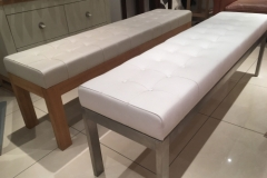 Deep button leather benches with oak and stainless steel frames.