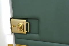 Leather applied to interior front door accommodating existing locks and handles.