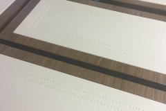 leather panels with stitch detail on drawer fronts.