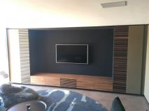 Feature TV wall with leather panels.
