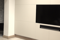 Leather wall panels surrounding TV and audio equipment.