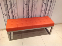 Statement 'orange' leather bench with padded 'deep button' effect seat and brushed stainless steel frame.