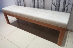 Padded leather seat with white oak frame.