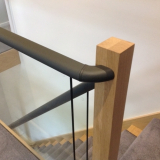 Flat handrail covered in leather.