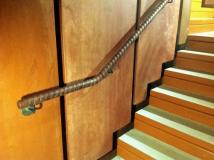 Tennis racket wrapped handrail.