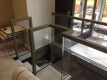 square handrail on glass balustrade.