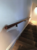 Brown leather applied to handrail in Chelsea apartments
