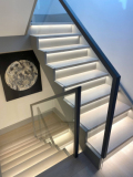 Square profile leather handrail on glass