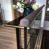 Brown leather handrail on glass balustrade