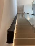 dark brown leather handrail