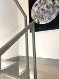 Bespoke handrail for glass balustrade covered in leather and fit on-site.