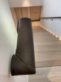Stitching on ends and seam lines of oval leather handrail. Chelsea Creek project.