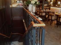 Tan leather handrail in Dover Street, London Restaurant