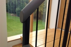 Leather handrail on spindles.