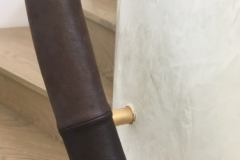 leather handrails on brass brackets