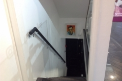 black leather handrail with chrome brackets.