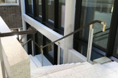 Leather on brass handrail