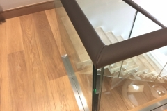 Dark Brown leather covered handrails in Chelsea apartment.