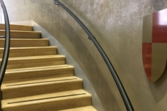 Curved black leather handrail