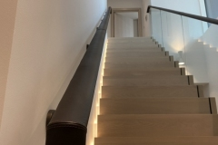 dark brown leather handrail