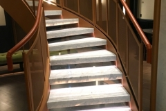 Tan leather handrail in London Hotel.