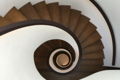spiral-staircase-leather-handrail