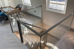Bespoke handrail in leather made to fit on glass balustrade.