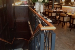 Tan leather handrail in Dover Street, London Restaurant