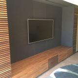 leather wall panels with walnut wood surround