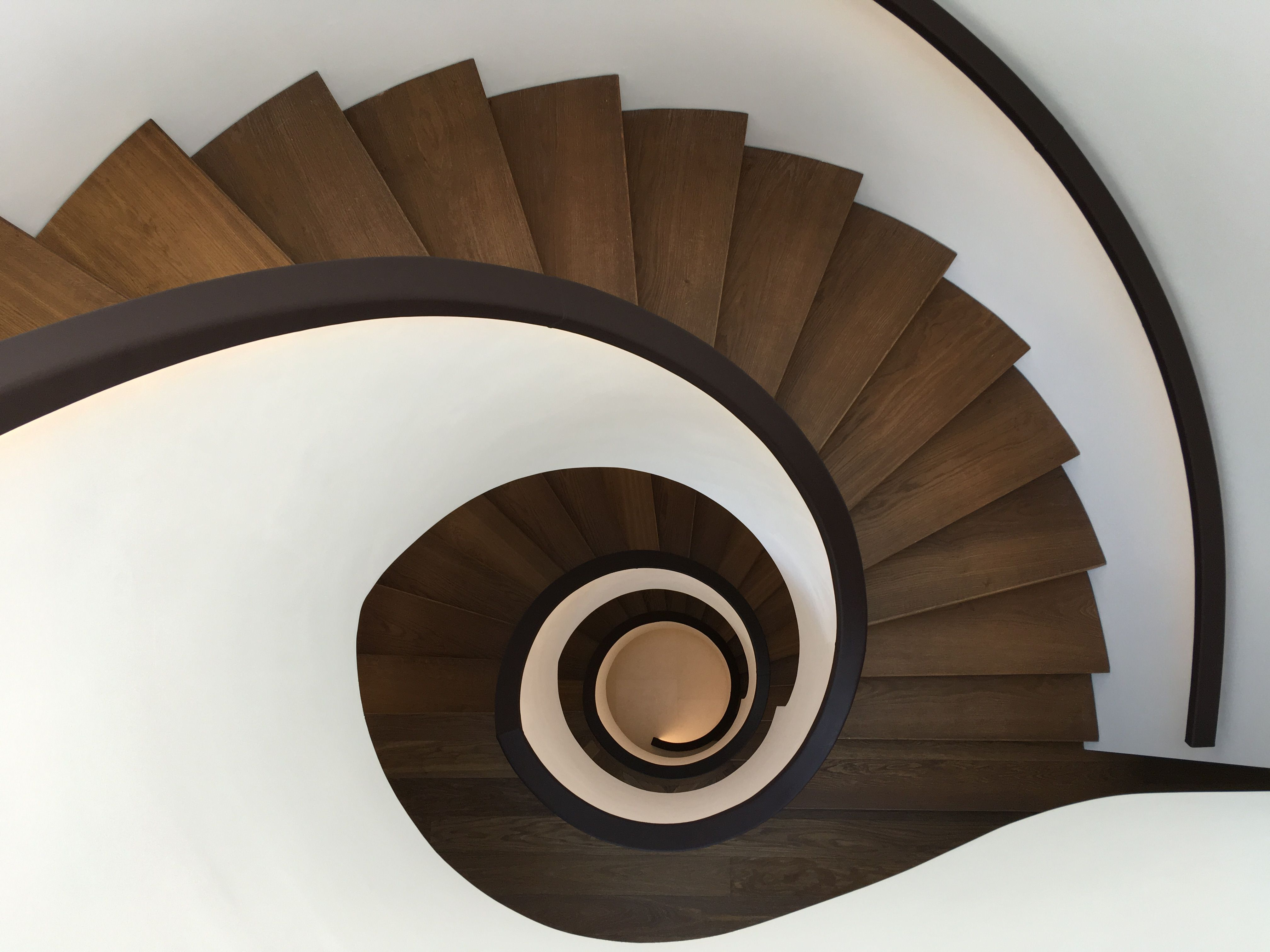 spiral staircase leather handrail