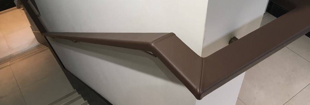 Flat bar handrails covered in leather on-site